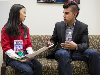 Bobak Ferdowsi, Flight Director, Mars Curiosity Rover, answers questions from Scholastic News young reporter Emily Shao prior to the start of the first-ever State of Science, Technology, Engineering and Math Event (SoSTEM) held at the Eisenhower Executive Office Building, Wednesday, Feb. 13, 2013.