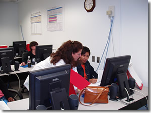 A photo of people being trained on the CRIS system.