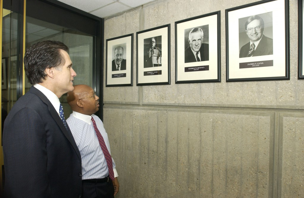 """Mitt Romney viewing a portrait of his father, George Romney, with HUD Secretary Alphonso Jackson,"" May 3, 2004"