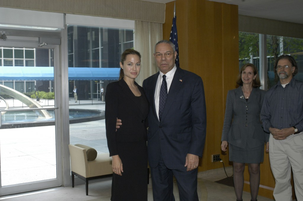 Actress Angelina Jolie with State Secretary Colin Powell at a reception in the Harry S. Truman Building