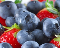 Whole blueberries and strawberries