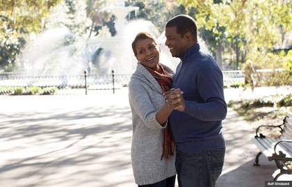 A couple dance in front of the fountain at Forsythe Park in Savannah, Georgia