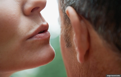 Woman whispering to man, Sex at 50+