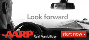 Look forward-AARP Real Possibilites-photo of man looking down road with reflection in rear view mirror