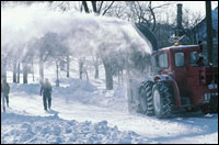 Photo: A snow thrower clearing a street.