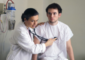 Photo of a doctor with a stethoscope examining a patient