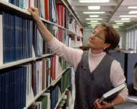 Librarian and bookshelves at the NIH library