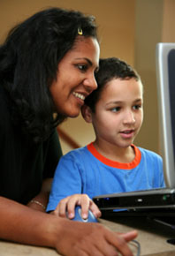 woman and child in front of a computer