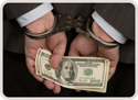 man in handcuffs with money in his hands