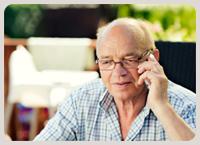 senior man talking on a telephone