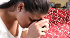 A young Latina is stressed, thinking about her positive diagnosis for HIV, the virus that causes AIDS