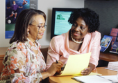 Photo of two institute staff members in a meeting