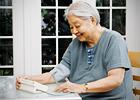 An elderly woman checks her blood pressure