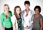 Four women wear HIV/AIDS red awareness ribbons
