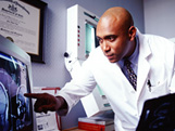 Photo of doctor examining test results.