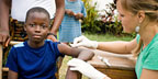 Young boy receiving a vaccine.