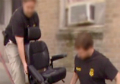 Agents confiscating wheelchair
