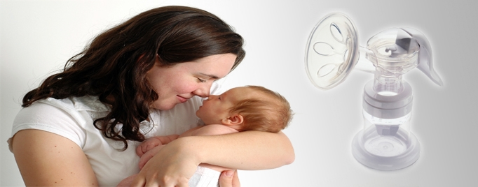 Woman snuggling with infant; breast pump