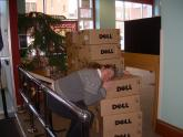 A library staff member hugs a shipment of new Dell computers