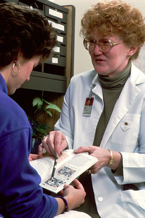 Nurse discussing palliative care choices with a patient