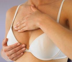 woman giving self breast exam