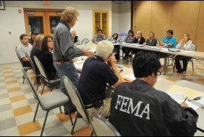 FEMA staff present information regarding FEMA's public assistance program to members of the Fond du Lac Band of the Lake Superior Chippewa. (August 2012)