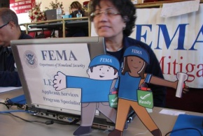 Flat Stanley and Flat Stella visit a FEMA Disaster Recovery Center specialist who is discussing mitigation best practices with Hurricane Sandy survivors.
