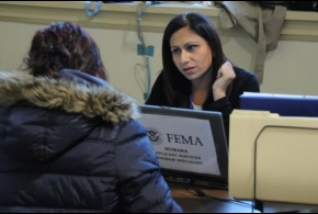 A FEMA Applicant Services Program Specialist speaks with a disaster survivor at a Disaster Recovery Center.