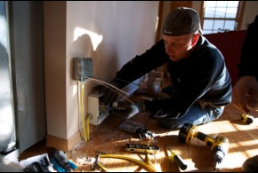 In New York, an electrician installs a heat register as part of the FEMA Sheltering and Temporary Essential Power (STEP) Program to help people get back into their homes quickly and safely.