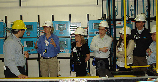 NRC Chairman Allison Macfarlane (2nd from left) talks with Indian Point Operations Manager John Dinelli (left) about safety issues at the nuclear plant in Buchanan, N.Y. Also pictured are other plant staff, NRC employees and staffers of Rep. Nita Lowey, D-N.Y.), who accompanied the chairman on the plant tour. (Photo Credit: Entergy)