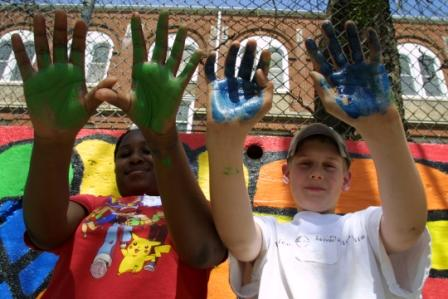 youth with paint on their hands