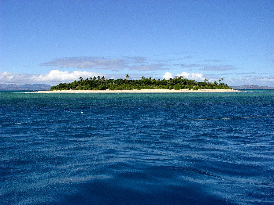 Image of an island on the sea with blue sky