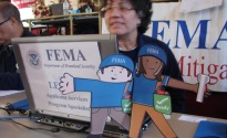 New York, N.Y., Dec. 15, 2012 -- Flat Stanley and Flat Stella visit a FEMA Disaster Recovery Center (DRC) specialist who is discussing mitigation best practices with Hurricane Sandy survivors.