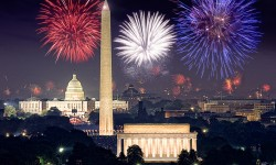 Fourth of July fireworks splash the sky with reds, whites and blues above the Lincoln Memorial, Washington Monument and U.S. Capitol.
