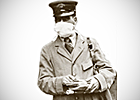 A mail carrier wears a mask to cover his mouth