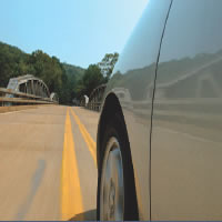 Lane Departure Warning (LDW) monitors lane markings on the road and cautions driver of unintentional lane drift.