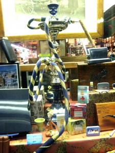 Waterpipe and other tobacco products displayed in a store window