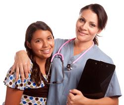 Photograph of a nurse with a teen girl.