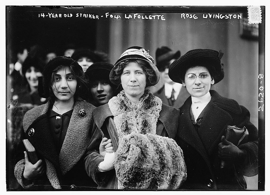 Image description: A 14 year old old striker stands with Fola La Follette and Rose Livingston. This photo was taken between 1910 and 1915 and published by Bain News Service. Photo from The George Grantham Bain Collection, Library of Congress. The Bain Collection contains the photographic files of one of America's earliest news picture agencies.