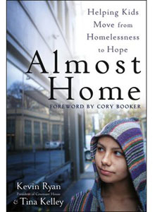 Book cover of Almost Home, showing a young person wearing a hoodie.