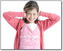 Girl blocking her ears from noise