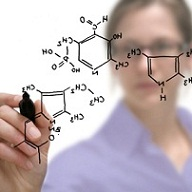 Researcher writing molecular structure