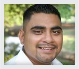 Latino guy smiling