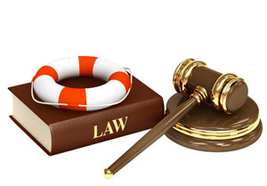 Photograph of a law book, a gavel, and a life preserver.