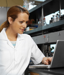 Woman researcher looking at computer screen