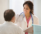 Woman doctor talking to a patient