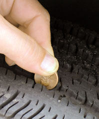 photo of penny placed in tire tread