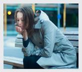 Homeless girl on a bench