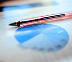 Image of a pie chart printed on a piece of paper, with a pen resting on the paper.