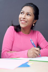 Photograph of a woman filling out forms.